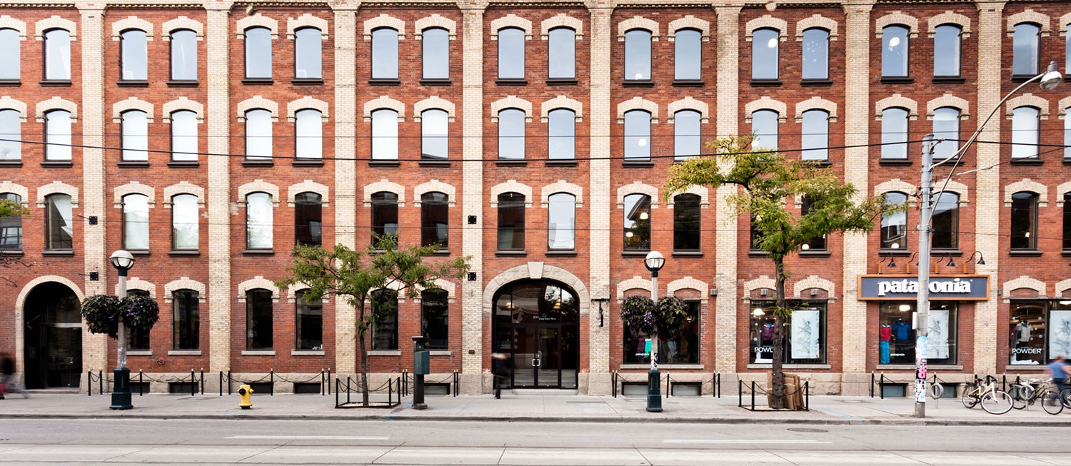 Allied discovered one of the best two-tone brick façades in Toronto beneath sheets of tin siding.