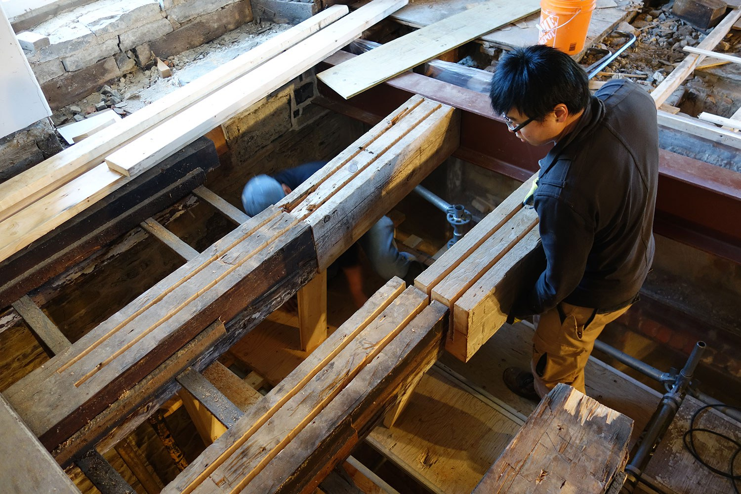 New and old timber sections prepared for insertion of reinforcing steel plates