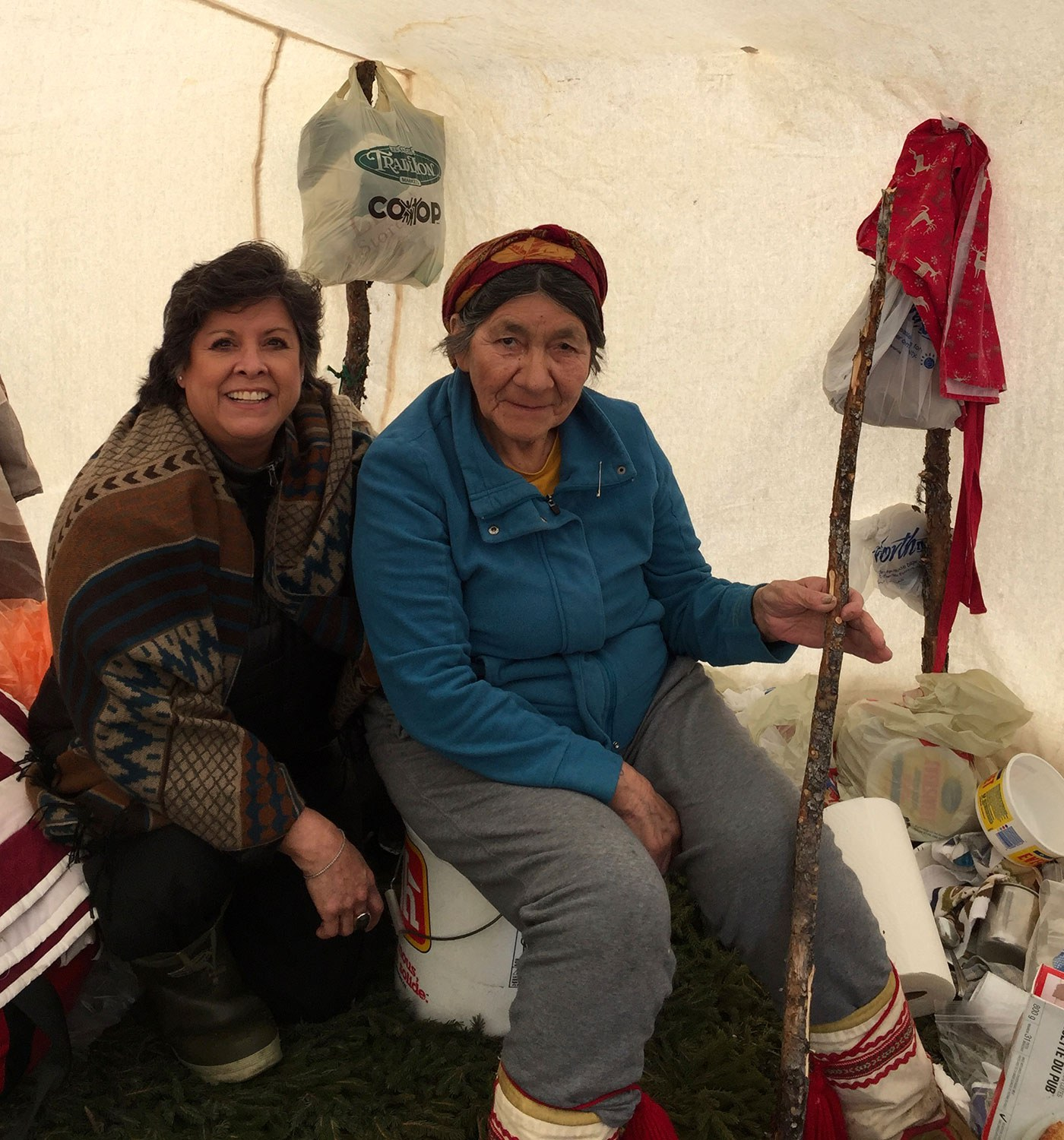 Dr. Wesley-Esquimaux (left) with Elizabeth Penashue, who was born into an Innu hunting and trapping family that lived at Kanekuanikat, between Esker and Churchill Falls, Labrador. Penashue moved to Sheshatshiu in the 1960s when her family and her people were encouraged to relocate in order to integrate them into Canadian society through education and a more settled lifestyle. Photo courtesy of the author.