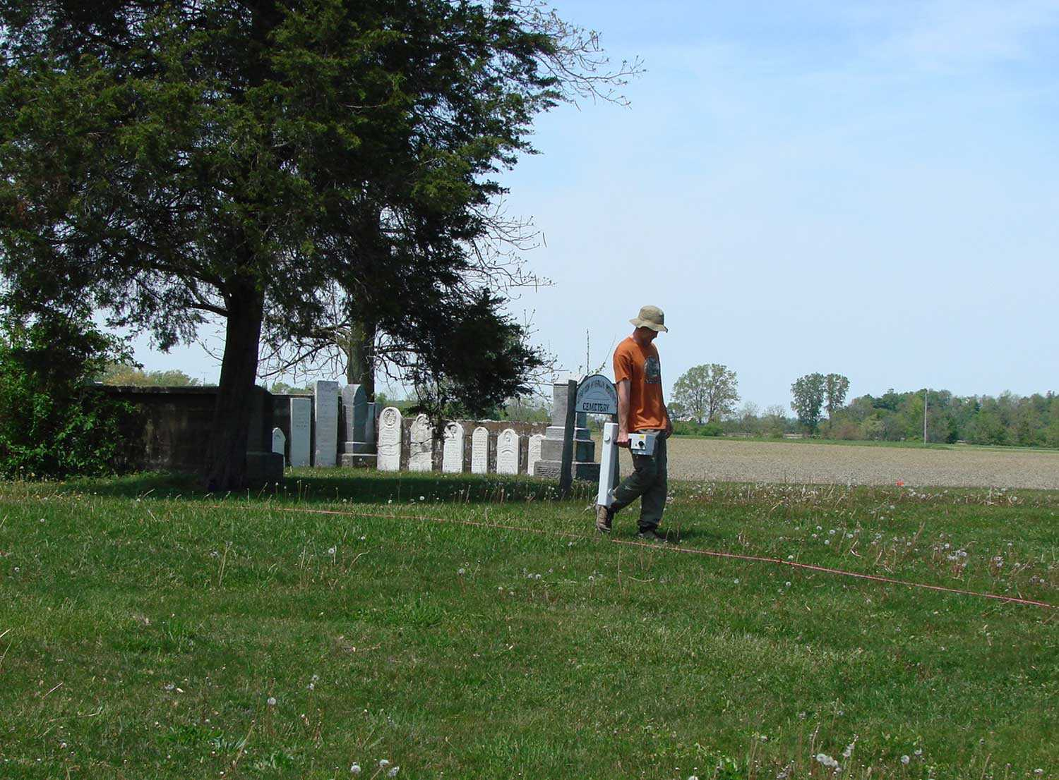Gradiometer survey method being used at the British American Institute Cemetery located across the road from the Trust's Uncle Tom's Cabin Historic Site in Dresden