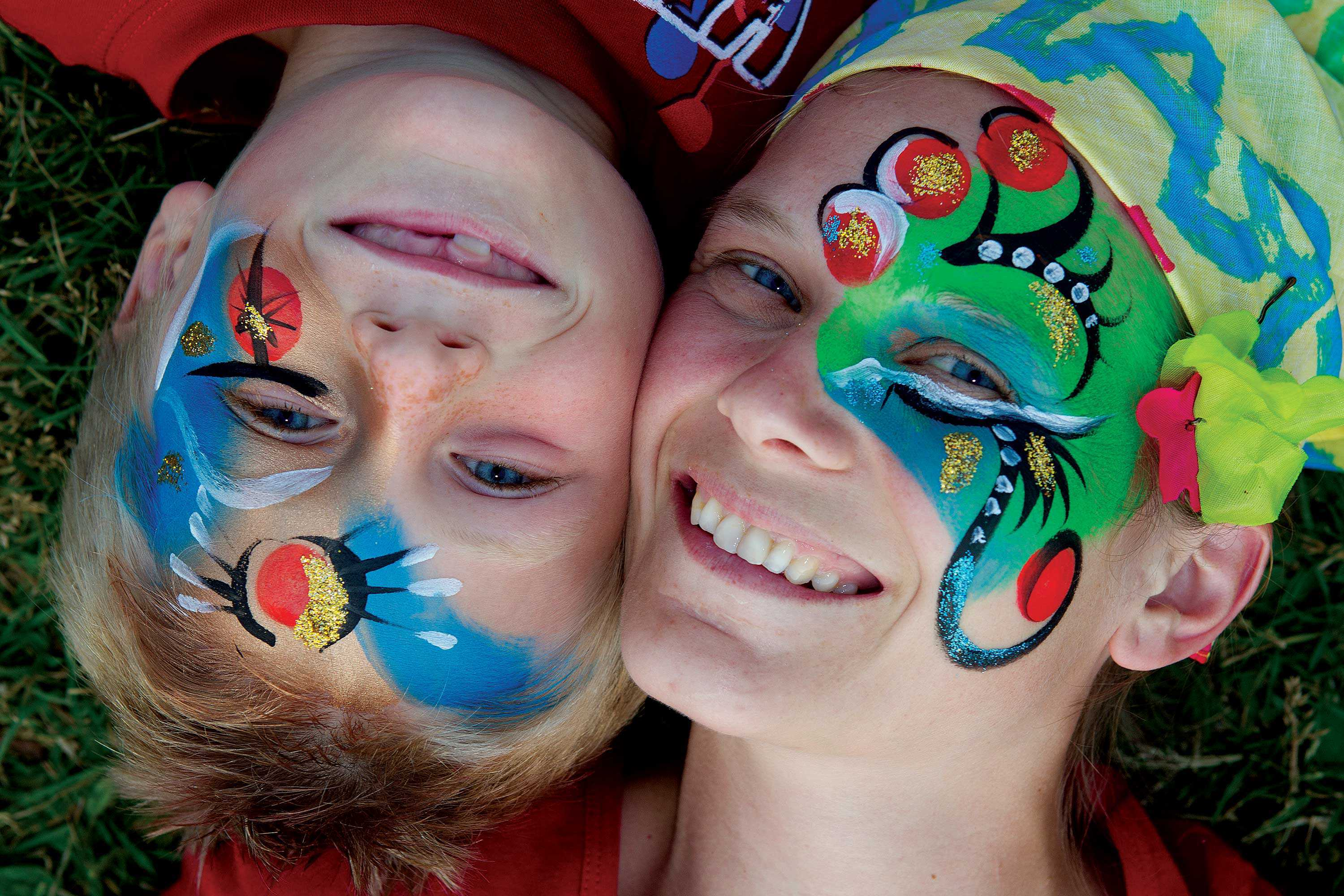 Woman and child in colourful make up