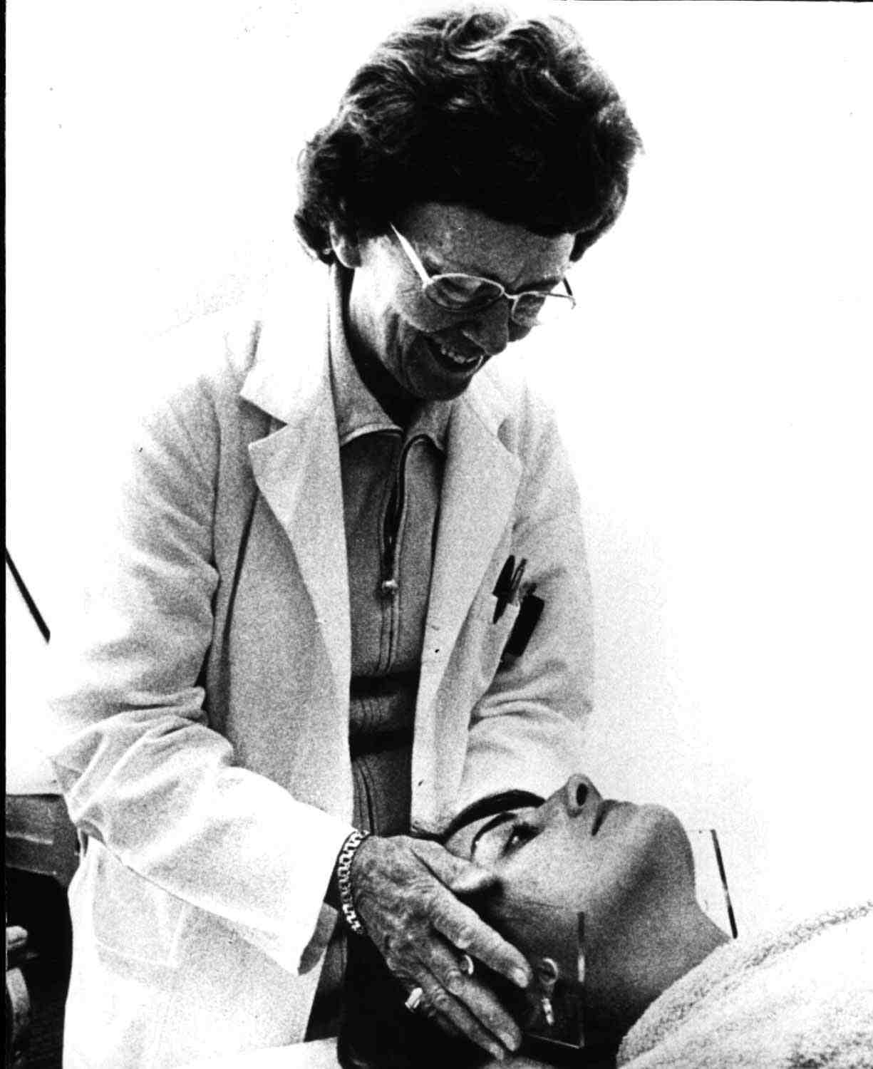 Dr. Peters adjusting a patient for radiotherapy. Collection of Dr. Charles Hayter.