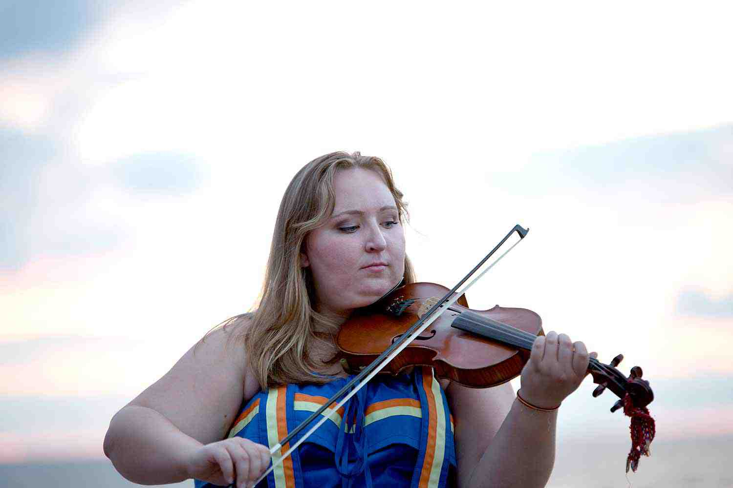 Métis Nation of Ontario woman playing the fiddle