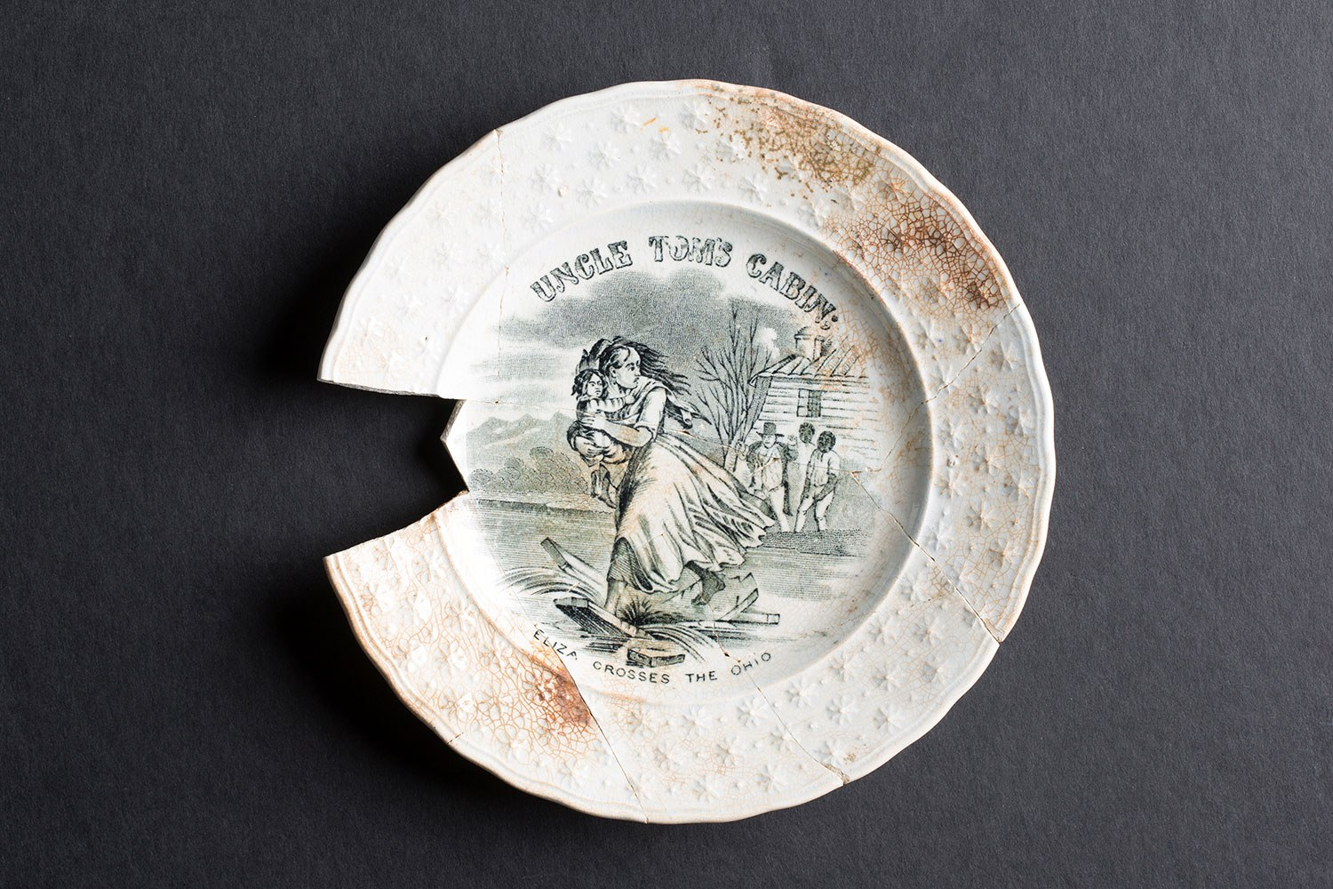 A plate adorned with a scene from Uncle Tom's Cabin (Photo courtesy of Timmins Martelle Heritage Consultants Inc. and Infrastructure Ontario)