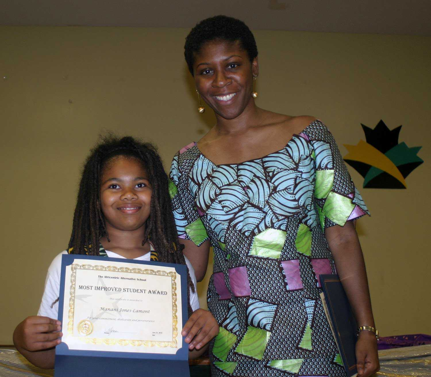 Former student Manani Jones (left) received the Most improved student award from Principal Hyman at the inaugural AAS gala in June 2010. Photo: Africentric Alternative School