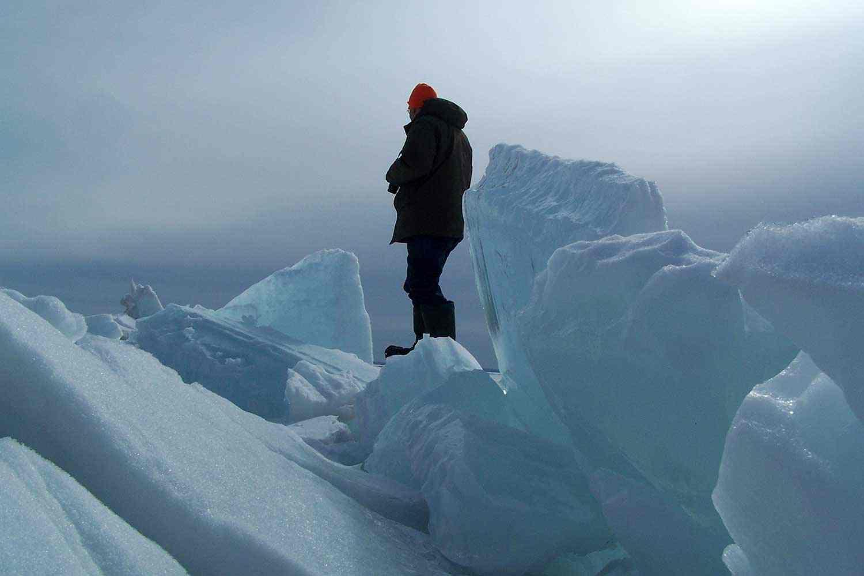 Fieldworker on ice ridges overlooking Lake Nipissing at Great Manitou Island, 2010.