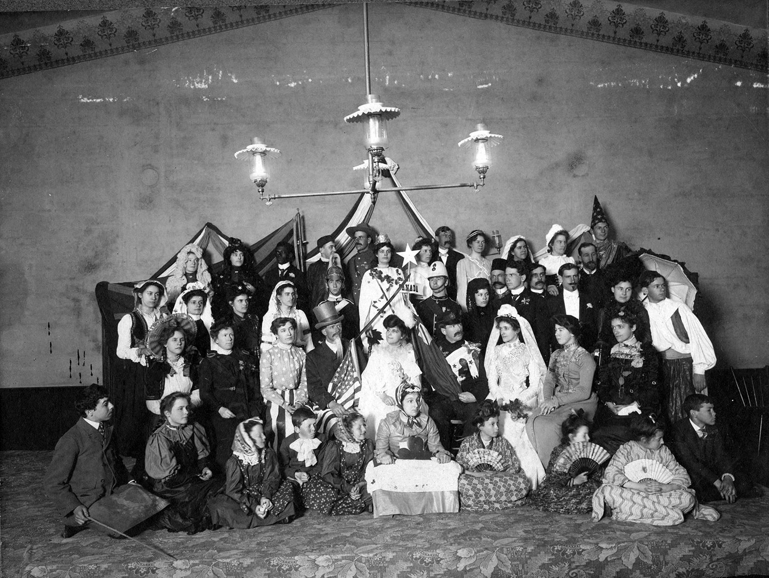 """Photograph taken by Wellington Ashbridge of an amateur play, """"The Happiest Land,"""" at Queen Street East Methodist Church (1902)"""