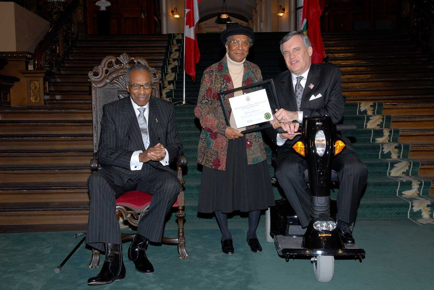 Wilma Morrison received a Lieutenant Governor's Ontario Heritage Award for Lifetime Achievement in 2007 from the Ontario Heritage Trust, presented by The Honourable Lincoln M. Alexander (left) and The Honourable David C. Onley, Lieutenant Governor of Ontario.