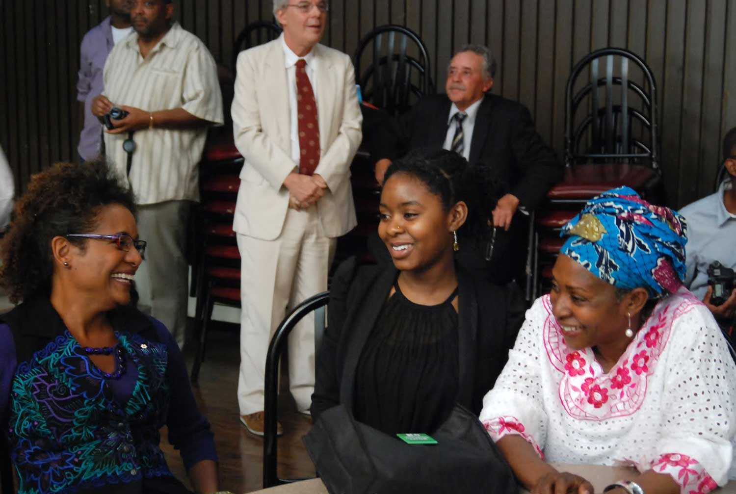 Former Governor General Michaëlle Jean shares a moment with Dr. Afua Cooper (right) and her daughter Habiba Diallo (centre) at the Harriet Tubman Institute event on August 27, 2011.