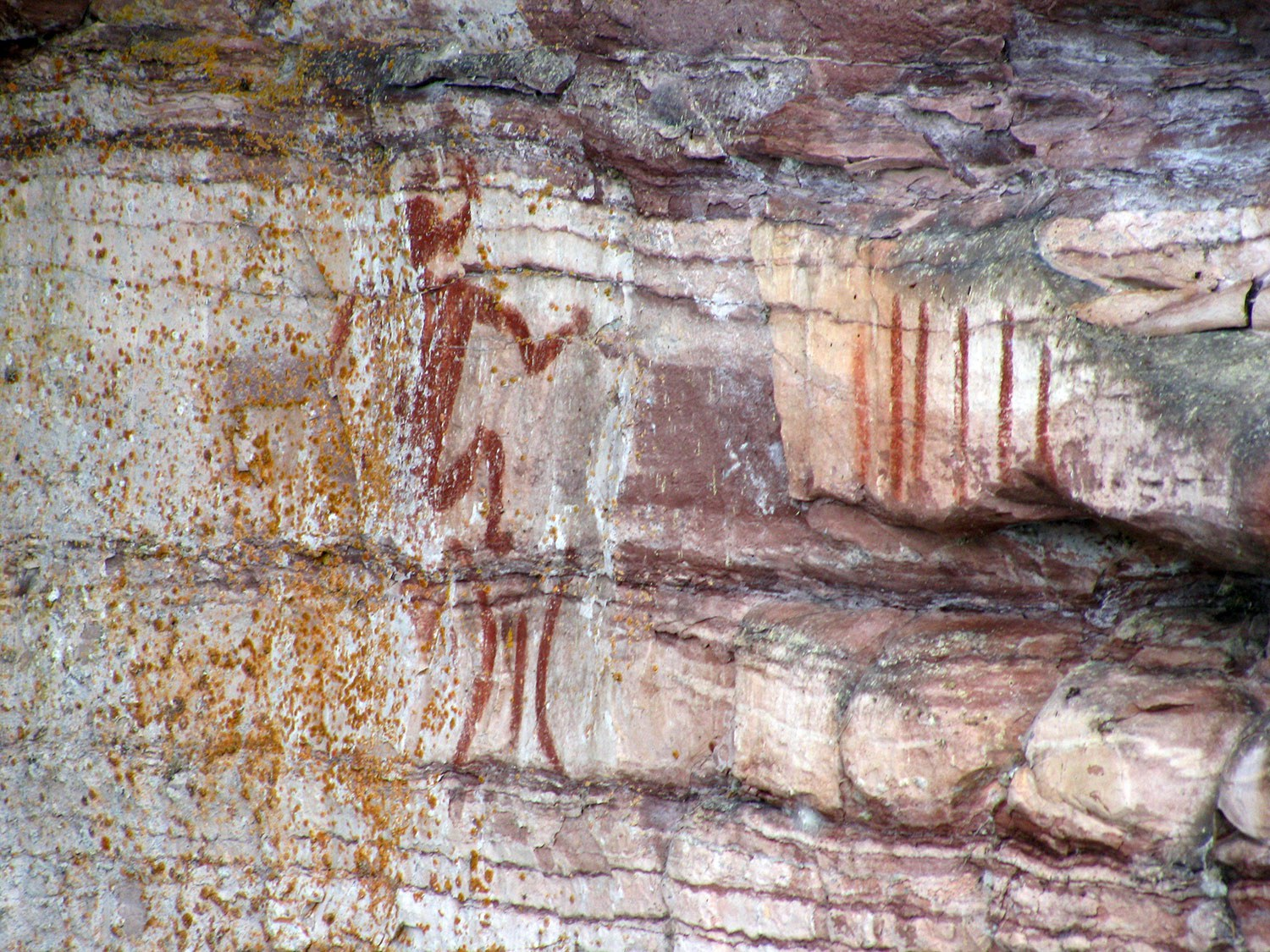 One panel of the extensive display of pictographs at the Nipigon River site. The image near the centre is clearly distinguishable as a large canoe