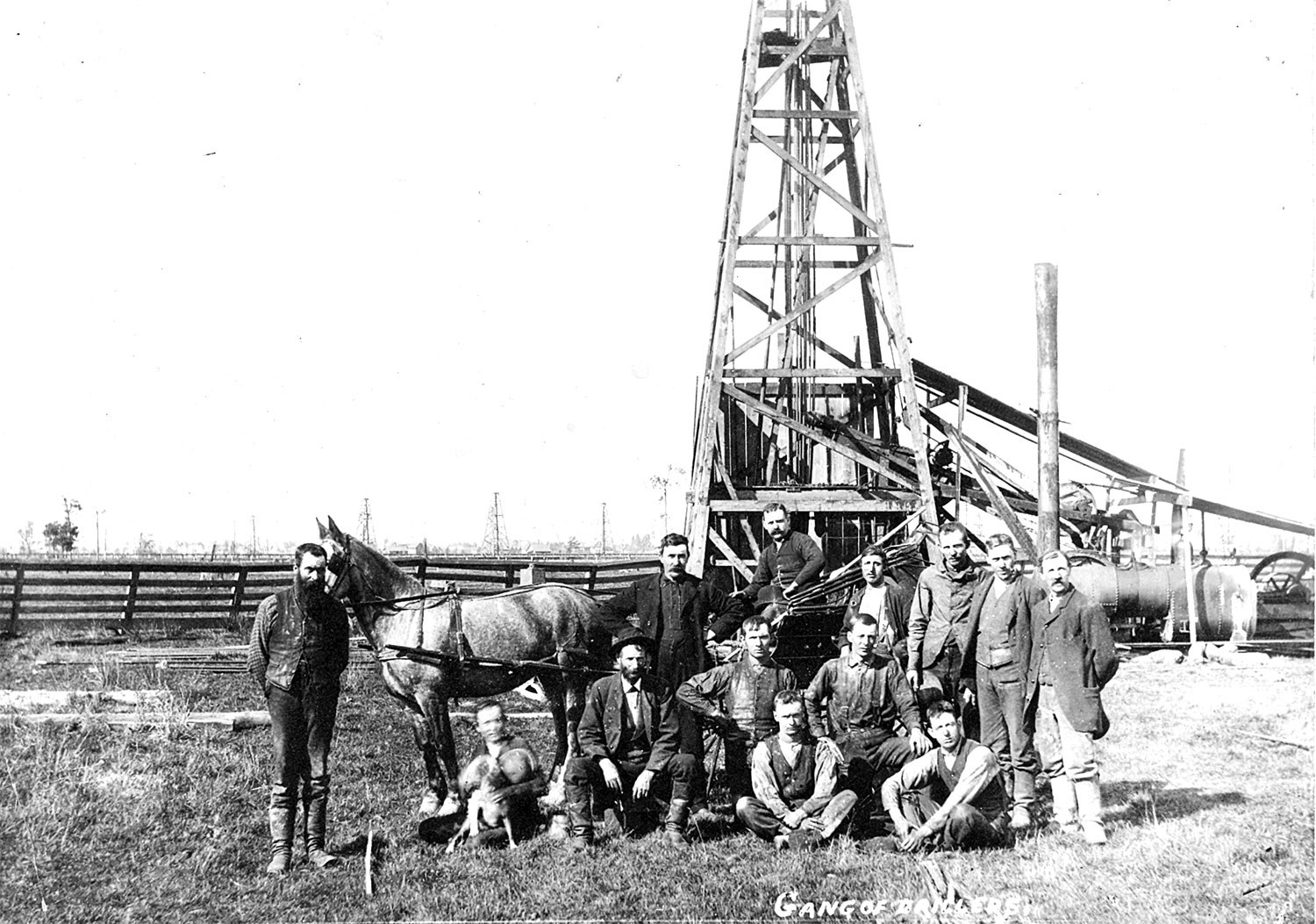 A drill crew at Petrolia in 1910, standing before their steam-powered drilling rig